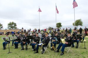 The Army National Guard's 40th Infantry Division Band, under the direction of Chief Warrant Officer Eric Sugunamu, played patriotic musical selections. Veterans of each of the nation's uniformed services stood for recognition as a soloist sang their service's song.