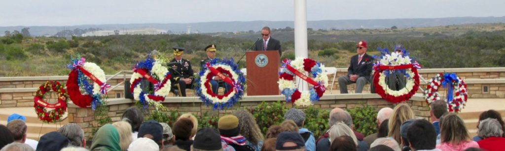 Some 600 veterans and their families, along with active duty military, and members of the public attended the fifth annual Veterans Memorial Service, May 29, at Miramar National Cemetery. Cemetery Director Rex Kern welcomes the audience to the ceremony.